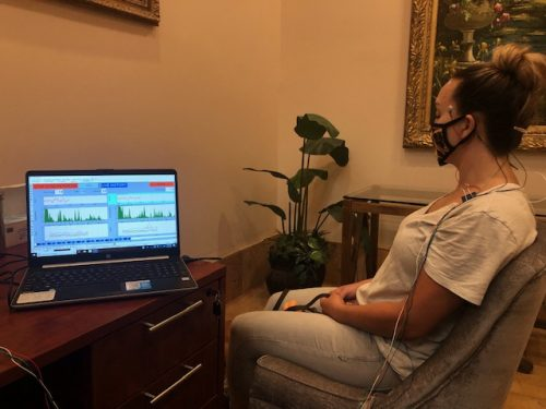 Micro Current Neurofeedback patient watches her brainwaves registering on a computer screen